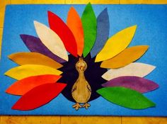 Fun with Friends at Storytime: Turkey Feathers felt craft. Come visit the School House for your felt board needs. A great way to teach little kids colors and have fun too!