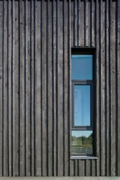Charred wood vertical siding planks provide depth and shadow to the facade, seen here at this window opening detail a Fire Station 76 by Hennebery Eddy Architects. House Cladding, Timber Cladding, Exterior Cladding, Cladding Ideas, Timber Battens, Cladding Materials, Exterior Stairs, Wall Exterior, Wood Architecture