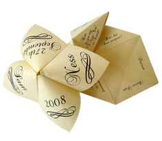 "Elementary School Paper ""Cootie catchers"" game for the guests to play with during dinner."