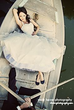 ROW BOAT AERIAL. Great vintage vibe. Love the contrast of the old rowboat and the beautiful, elegant bride. Fun angle with just the groom's leg. Simply awesome. Classic and unique wedding photo idea. Wedding photoshoot ideas; wedding photography; wedding photos. #WeddingPhotos #WeddingPhotography