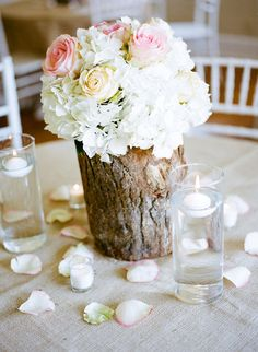 Such a creative centerpiece. Love the tree base with white/pink flowers. #tree #centerpiece