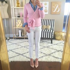 Pink wrap sweater layered with chambray shirt, white jeans and nude pumps // Click for details here: http://www.stylishpetite.com/2015/03/dvf-spring-stripes-burberry-trench-coat.html