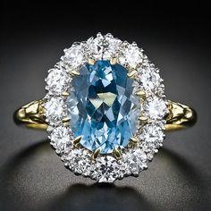 Aquamarine and diamond halo ring. At Lang Antiques.