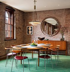Dining Room. Architect Andrew Franz has transformed the top floor and roof of an 1884 caviar warehouse, into a contemporary open plan residence in New York.