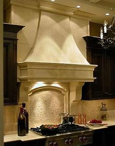 stone hood in kitchen-would love the matching fireplace!