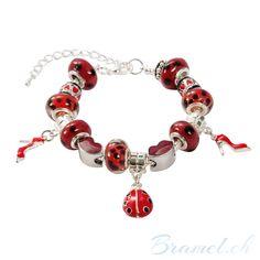 Charm Armband mit Marienkäfer und Lippen - http://bramel.ch/accessoires-shop/armband/charm-armband-mit-marienkaefer-und-lippen/ http://bramel.ch/wp-content/uploads/2014/02/Armband-Charms-kristalle-lippen-und-marienkäfer-600x600.jpg