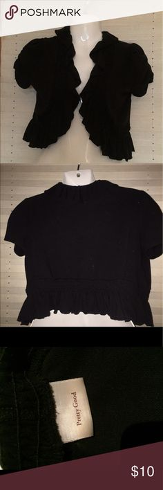 Black Ruffled Shrug As I said in another post, you are either a ruffle person or you are not, but I am and this is another one of my pieces that I have to part with- reluctantly. It's very versatile and I found an opportunity to wear it a lot. Gently used with some slight pilling but has plenty of life left in it. It's a soft stretchy poly material- very little if any fade. Size tag is not there but I estimate a M - that's why I am selling😭 Pretty Good Jackets & Coats Capes
