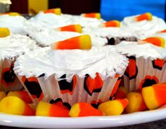 Moist White Cake Cupcakes with orange food coloring. White Frosting and Candy Corn. Fun & Yum!