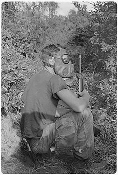 A Marine from the 7th Regiment, gets ready to enter a VC tunnel in Vietnam. ~ Vietnam War