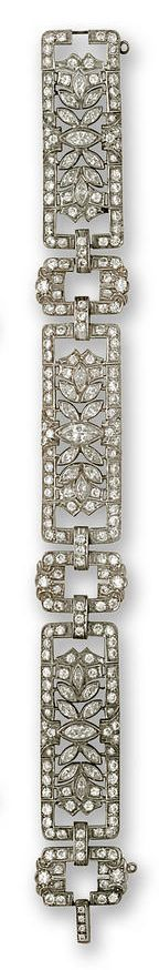 A diamond bracelet  of openwork design, with three rectangular panels centering marquise-cut diamond clusters with round brilliant-cut diamond borders, completed by oval spacers of round brilliant-cut diamonds; estimated total diamond weight: 8.50 carats; mounted in platinum; length: 7 1/2in.