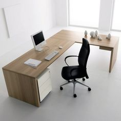 An 'off-the-peg' L-shaped desk works great in most corners of the home, and looks good freestanding too.