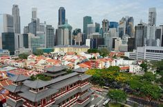 The Buddha Tooth Relic Temple in Chinatown, with Singapore's skyline beyond.