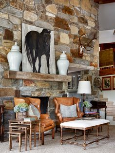 Great equestrian art for a mantel in a family room.