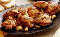 Roasted Garlic Clove Chicken : Juicy, herb-crusted chicken thighs make a comforting yet perfectly elegant main dish for a holiday celebration. The soft, roasted garlic cloves are excellent spread on fresh bread. via Food Network Roasted Garlic, Roasted Chicken, Garlic Clove, Garlic Chicken, Tumeric Chicken, Baked Chicken, Boneless Chicken, Balsamic Chicken, Healthy Chicken