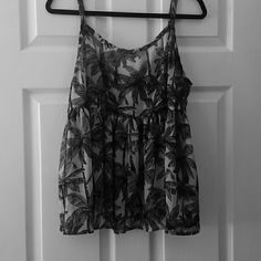 Back & white top This is a sheer, black & white palm tree print top! Probably my most favorite top, its so lightweight & versatile! Perfect for summer & its has adjustable straps! Must have for any closet. Dont want to part with this at all but its not my size anymore. Want this to go to a very good home! Lol torrid Tops