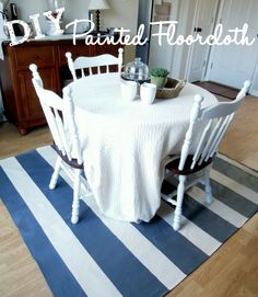 If you're looking for an inexpensive floor covering idea, a painted floor cloth is a great way to add style underfoot while on a budget. Floor cloths can be stylish and are easy to care for. Here's how I made our DIY Floor Cloth for the dining room. Painted Floor Cloths, Painted Floors, Painted Rug, Hand Painted, Drop Cloth Rug, Drop Cloths, Dyi, Easy Diy, Drop Cloth Projects