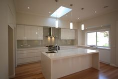 White cupboards with greyish splashback - Beige Royal (Dulux) on Starfire glass