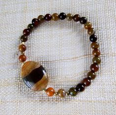 $15.50USD $20AUD Agate bracelet. Dragons Vein Agate with square brass spacers. Natural stones. Brown and black bracelet. Earth tones. Unique.Brown and orange #gemstones #jewellery #bracelet #accessories #fashion #bangle #handmadejewelry  #bohojewelry #customjewelry #jewelrylover #crystals #boho #wrapbracelet #silverbracelet #gemstonebracelet #gemstonejewellery #naturalstone #agate