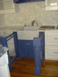 pullout storage for dish towels, sponges, plastic bags