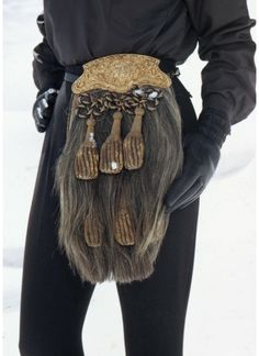[Ann Bonfoey Taylor wearing black with a Scottish sporran (purse) around her waist as part of a ski outfit, Colorado] Wearing Black, Bucket Bag, Sequin Skirt, Ann, Purses, The Originals, Chic, Skirts, How To Wear