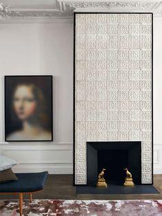 Studio KO: a tiled fireplace in an apartment on the Rue de la Sourdière, Paris