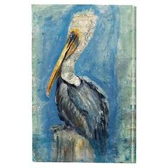 "With collage-inspired details, this canvas print of a pelican brings coastal appeal to your living room or study.  Product: Canvas artConstruction Material: CanvasDimensions: 36"" H x 24"" W x 1.5"" D"