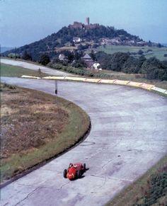 "Juan Manuel Fangio entering the ""Nordkurve"" at the German Grand Prix…"