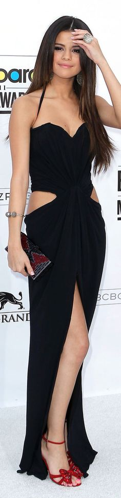 I like her ring, bracelet, clutch, and earrings. great makeup and hair too