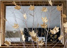 I could totally do this, gold leaves in the branches, more affordable than flowers :P