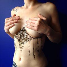 Tattoo inspiration - henna mehndi style chest tattoo, pretty & girly under boob sternum