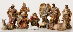 "8"" Heaven's Majesty Nativity Figure Set   Wood carved look, hand-painted in traditional colors. Beautiful 11 piece heirloom quality nativity set. Removable Baby Jesus! This stunning Nativity has some of the finest detail we've seen! The faces on these figures are painted with great care and the quality is visible. Figures are 8"" tall. (Item #23591)"