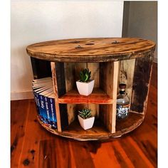 Our cable reel bookshelf coffee tables. Our cable reel bookshelf coffee tables. Round Bookshelf, Tv Stand Bookshelf, Bookshelves, Wire Spool Tables, Cable Spool Tables, Wood Shop Projects, Diy Projects, Recycled Furniture, Diy Furniture
