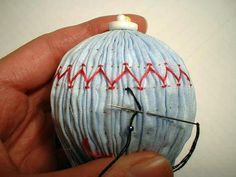 """Link to a tutorial that explains how to smock ornaments """"in the round"""".---This person has given a lot of thought to making some creative smocked ornaments!"""