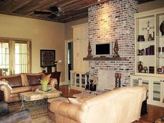 """Architectural Designs Acadian Style House Plan 56337SM - Family Room, 24'8"""" x 20' with 12' ceilings."""
