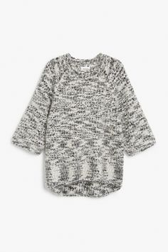 A big fuzzy delight of a sweater with wide ¾ sleeves and ribbed neck. Woven with a plushy-meets-furry melange yarn.