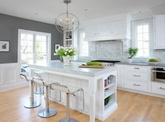 i like the contrast between the pebble caesarstone countertop and bianco carrara marble island...