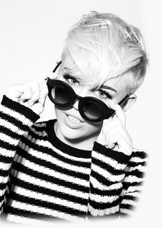 I don't care what anyone I love Miley's new hair, new look.. I seriously wanna cut my hair like that!!