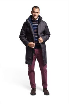 Coated polyester coat ($258) by Nautica; wool Fair Isle sweater ($98) by J. Crew; cotton shirt ($65) by Club Monaco; cotton chinos ($60) by Lands' End Canvas; leather boots ($110) by Steve Madden. Total $591