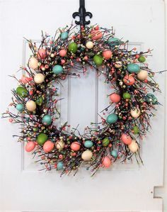 Measurements: The base is an 18 round twig wreath, finished size is approximately 22-23 in diameter (wider if you spray out the berry strands). This wreath is beautiful and would look very pretty above a fireplace or on a large wall in a foyer. These eggs look just like the ones we dye