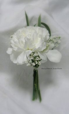 carnation, babysbreath and a touch of greenery for a simple, elegant bout.