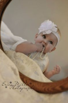 Little girl in mom's wedding dress with pearls. #photography #infant #baby by Erica Miller Photography