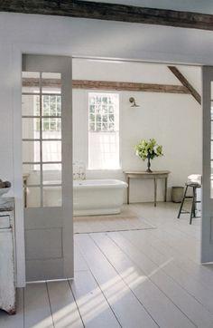 10 Elegant Interiors in Sophisticated Shades of Grey Attic bathroom- freestanding tub, barn doors