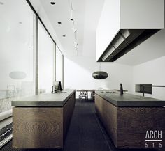 Combinacion de colores y texturas: Piso negro, madera de las islas de cocina y paredes y techo blanco