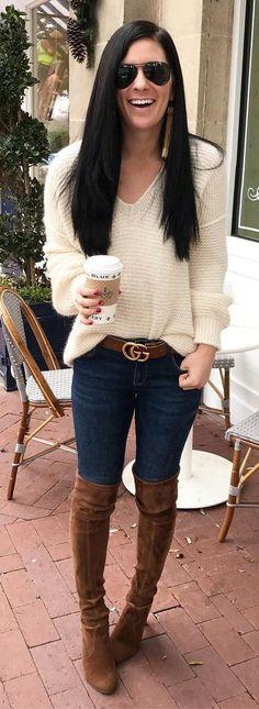 #winter #fashion / White V-neck Knit / Navy Skinny Jeans /brown OTK Boots