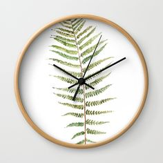 Buy Botanical Single Leaf Fern Wall Clock by susanbrand. Worldwide shipping available at Society6.com. Just one of millions of high quality products available.