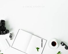 Black Notebook and Coffee on White Desk Styled Stock Photo
