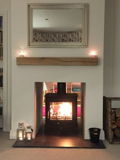 Our double sided wood burning with oak mantle piece. The fire place was original… - Wood Burning Fireplace Inserts Log Burner Fireplace, Wood Burning Fireplace Inserts, Home Fireplace, Wood Burner, Living Room With Fireplace, Fireplace Design, Fireplace Ideas, Cottage Fireplace, Inglenook Fireplace