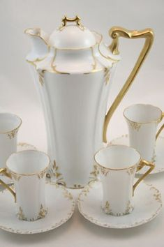 Double your traffic. Limoges France Chocolate or Tea Set White porcelain with hand-painted gilt accents and gilded handles. Very translucent porcelain. Auction includes lidded pot and four sets of cu Chocolate Pots, Chocolate Coffee, Antique Tea Sets, Raspberry Tea, Tea Pot Set, Teapots And Cups, Decoration Table, White Porcelain, Dinnerware