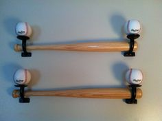 Another Pinner said: We are doing our son's big boy room in a baseball theme. My husband used hand rail mounts that he turned upside down. He screwed baseballs into them and mounted them to the wall . They are holding 2 bats that were given to our son as a gift from the baseball hall of fame!