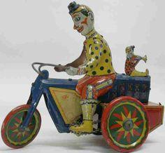 Fischer Heinrich Tin-Clowns German Tricycle with two clowns tin wind-